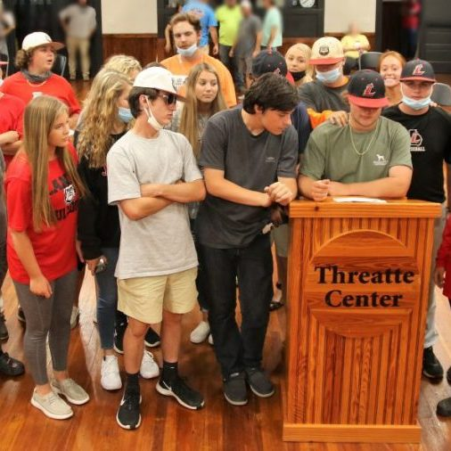 Pictured is Jacob Haircloth and other students who showed up at Monday's school board meeting in support of the current Bulldog baseball coaching staff.